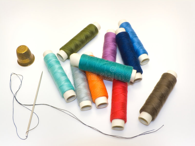 Threads and needle stock photo