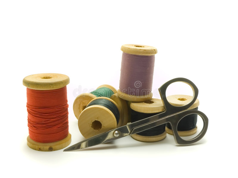 Threads and scissors royalty free stock image
