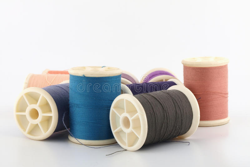 Download Threads in spools on white stock photo. Image of yarn - 20146380