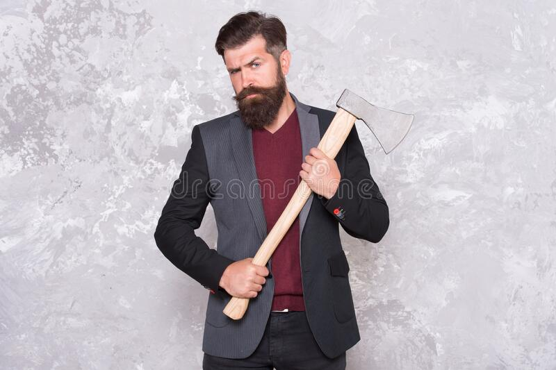 Threat to debtors. Debt collection is process of pursuing payments of debts owed by individuals or businesses. Brutal. Bearded man with axe. Collection agency royalty free stock photo