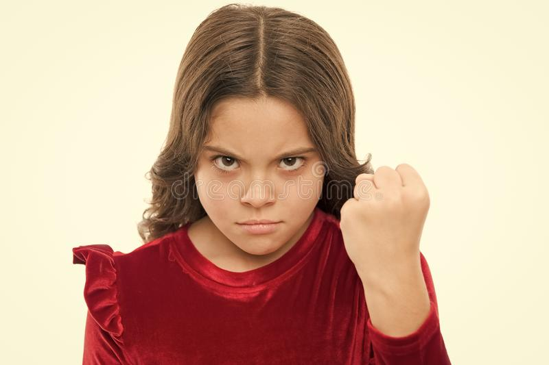 Threatening with physical attack. Kids aggression concept. Aggressive girl threatening to beat you. Dangerous girl. You stock image