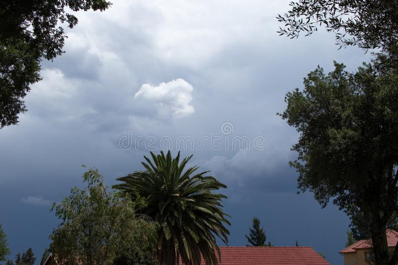 Seasonal stormy summer weather Gauteng South Africa. Threatening summer storm clouds gather above a residential area on the Gauteng Highveld in South Africa royalty free stock photos