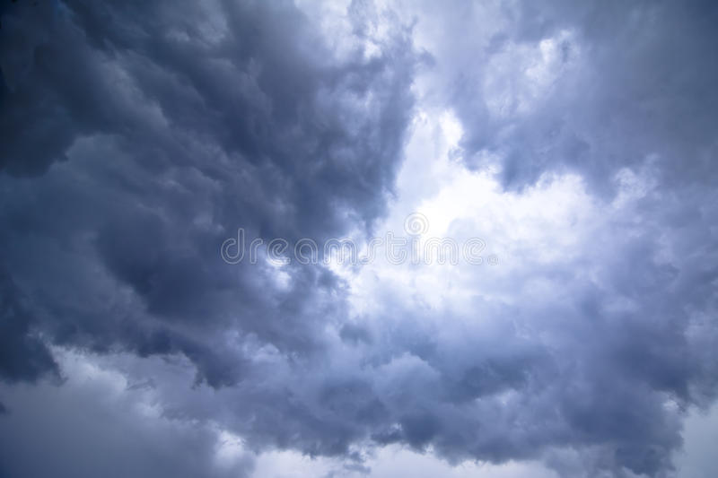 Threatening weather background. Dark threatening clouds with blue tone, background royalty free stock images