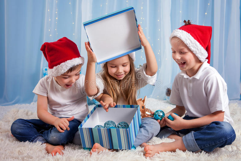 Three adorable kids, preschool children, siblings, having fun for Christmas stock photography