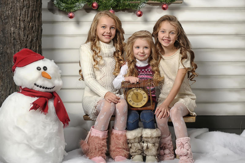 Three cute girls waiting for Christmas royalty free stock images