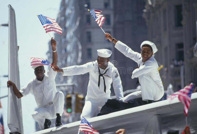 Three African-American Sailors in parade royalty free stock photography