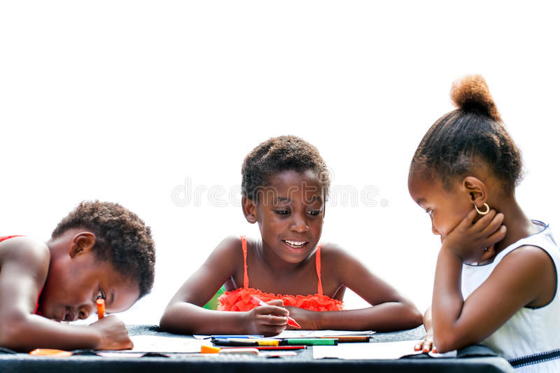 Three African kids drawing together. royalty free stock photo