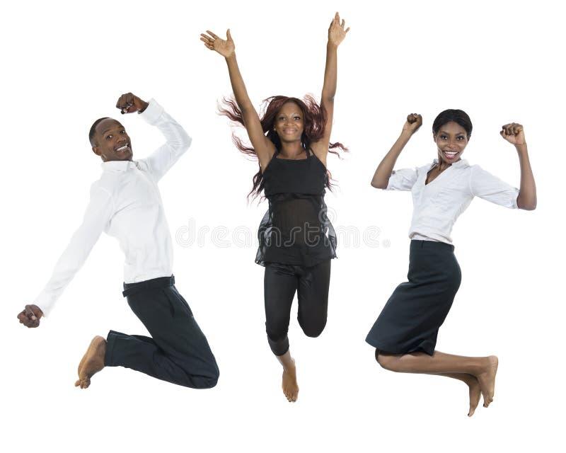 Three african peolple jumping high stock photo