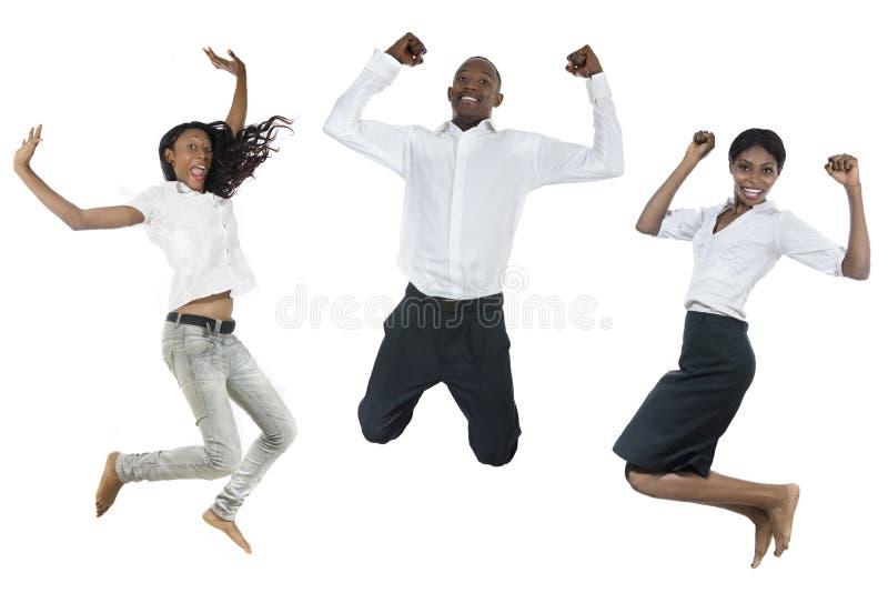 Three african peolple jumping high stock photography