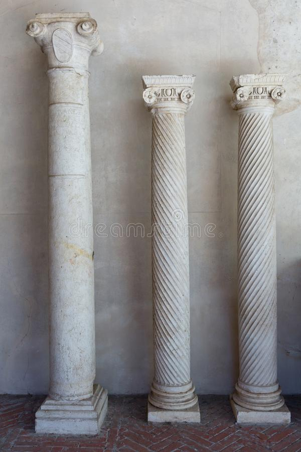 Three Ancient Architectural Columns inside Ducal Palace in Mantua.  stock photos