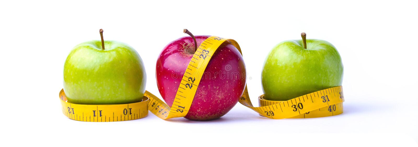 Three apples and measuring tape stock image