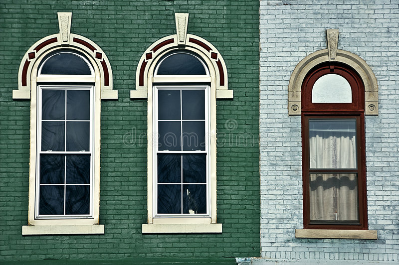 Three arched windows stock image