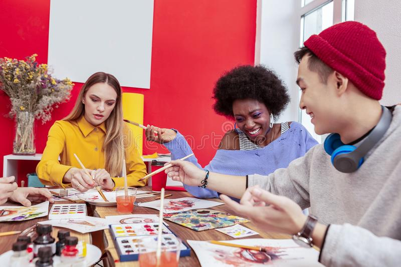 Three art students involved in preparing to important presentation royalty free stock photography