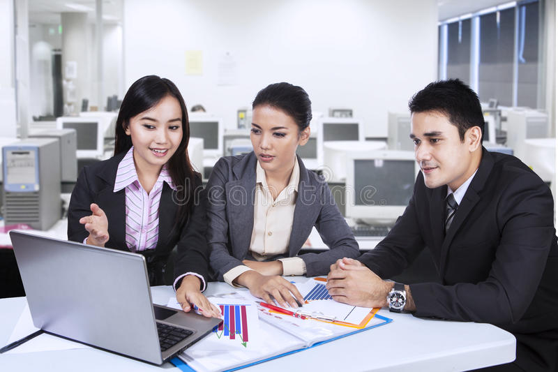 Three asian business team with laptop at office royalty free stock photos