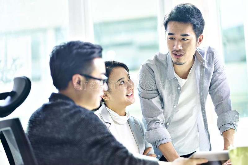 Three asian corporate executives meeting in office royalty free stock photography