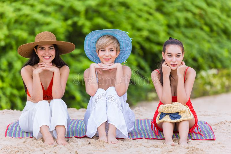 Girls teen friend holiday vacation on the beach happy smile. Three Asian fashion girls teen friend holiday vacation on the beach stock photos