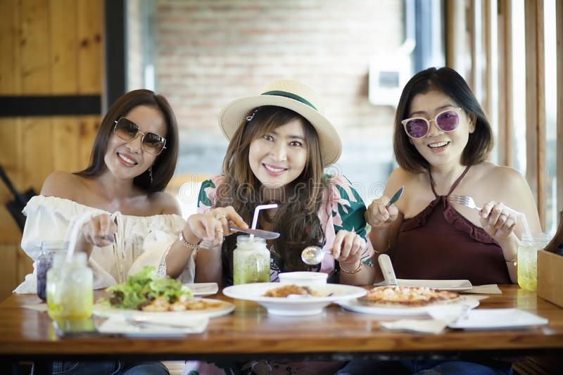 Three asian woman ready to eating western food on table stock photos