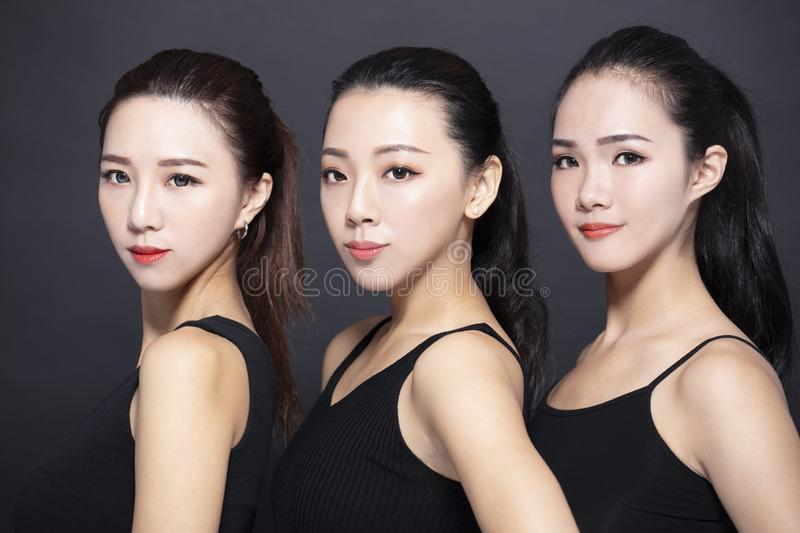 Three young beauty with black background royalty free stock images