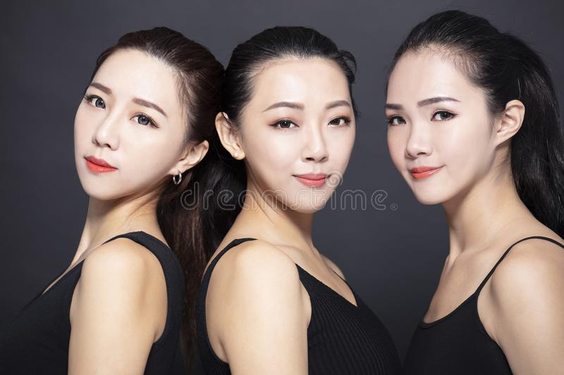 Three young beauty with black background stock photos