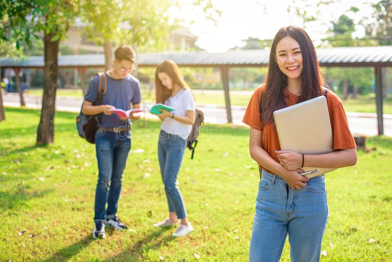 Three Asian young campus people tutoring and preparing for final royalty free stock photo