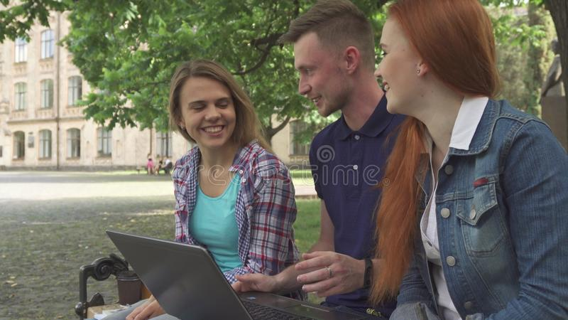 Students work on laptop on campus royalty free stock image