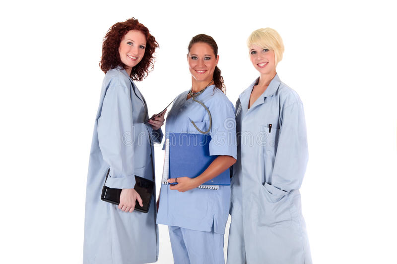 Three attractive female doctors royalty free stock image