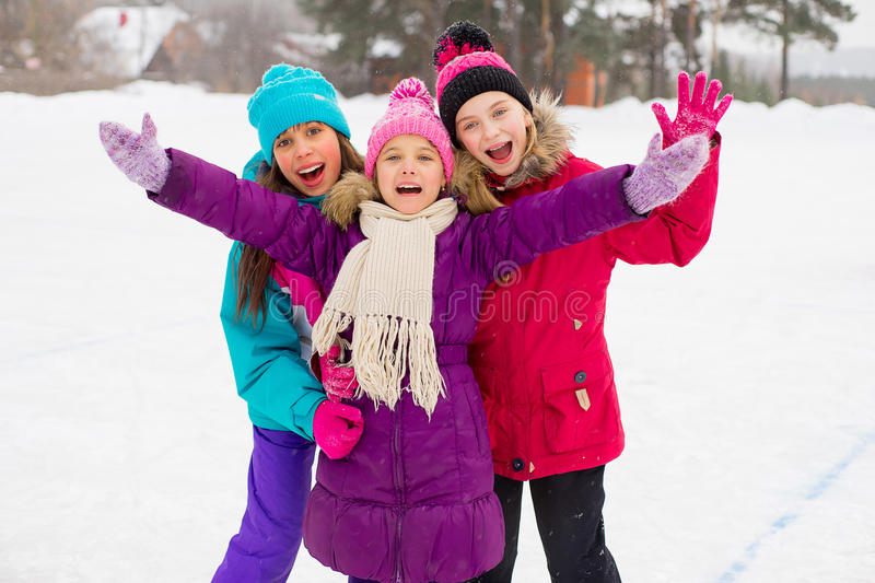Three attractive skater girl hug on the ice royalty free stock photography