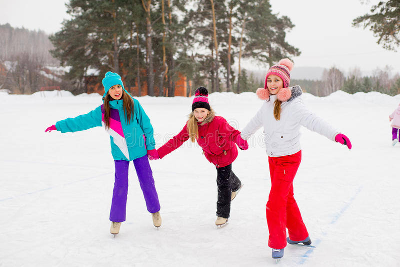 Three attractive skater girl on the ice royalty free stock photography