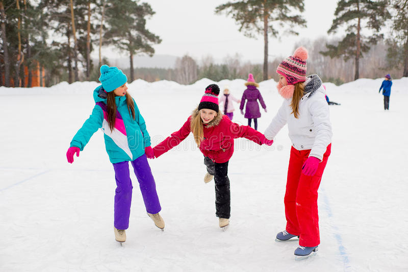 Three attractive skater girl on the ice royalty free stock photos