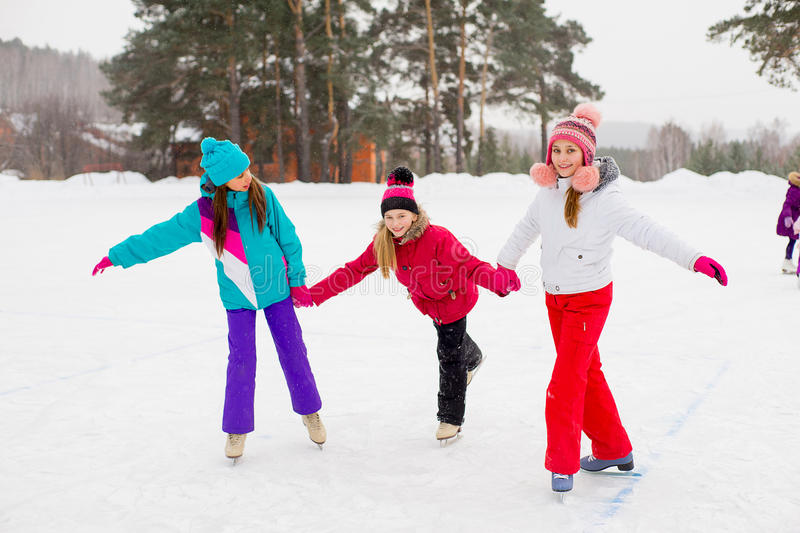 Three attractive skater girl on the ice stock image