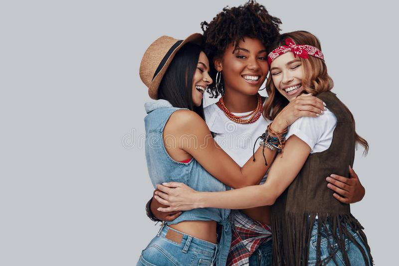 Three attractive stylish young women royalty free stock image