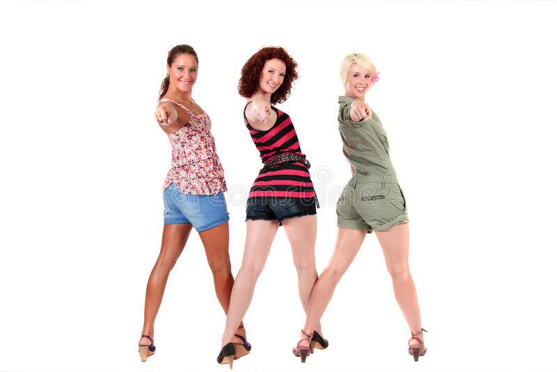 Three attractive young women pointing royalty free stock photo