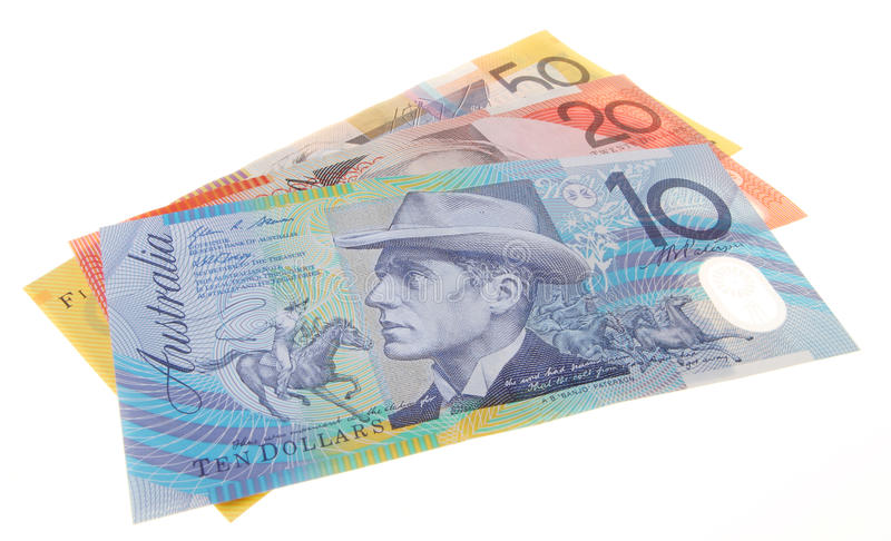 Three Australian bank notes. Including a $10, $20 and $50 dollar note isolated on white background royalty free stock photo
