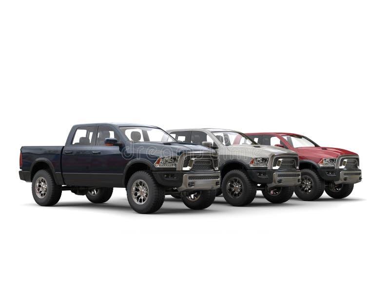 Three awesome metallic pick-up trucks - showroom shot royalty free stock images