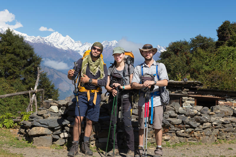 Three backpackers tourists posing, snow mountains peaks ridge. Three backpackers tourists group selfie posing in front snow mountains peaks ridge. Gosaikunda royalty free stock images