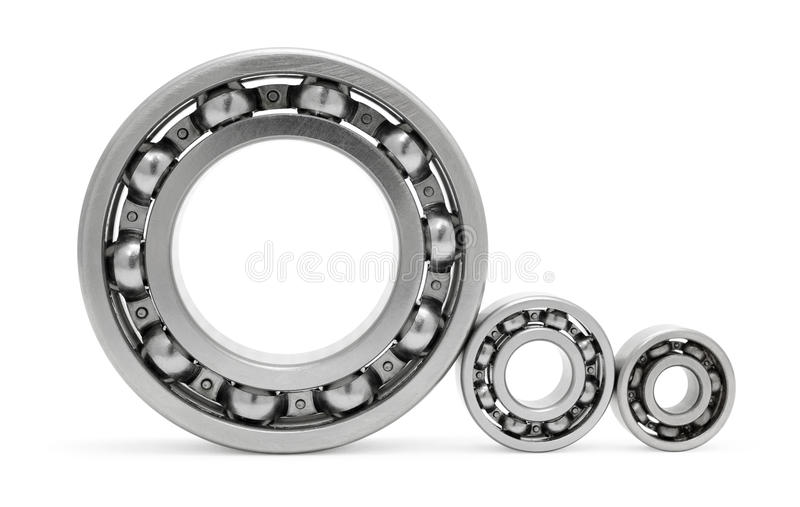 Three ball bearings. Over white, clipping path royalty free stock photo