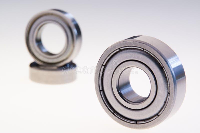 Three ball bearings on white. Product shot of three ball bearings White background stock photos