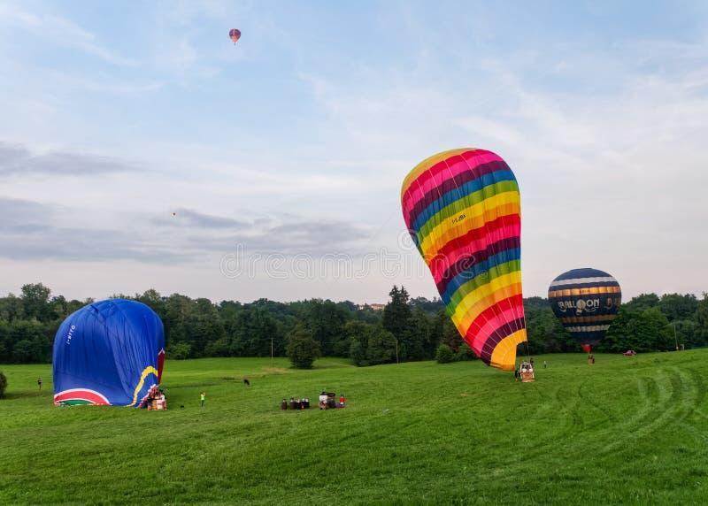Three balloons in deflating phase stock photos