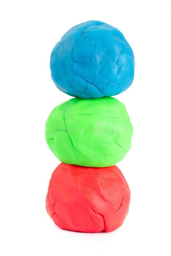 Three balls of play doh royalty free stock photography