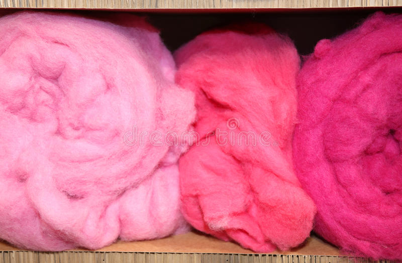 Three balls of very soft wool for sale. In the wholesaler's shop stock image