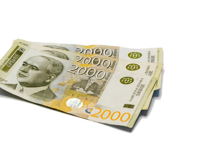 Three banknotes worth 2000 Serbian Dinars with portrait of a climate scientist Milutin Milankovic isolated on a white background. Three banknotes worth 2000 stock photos