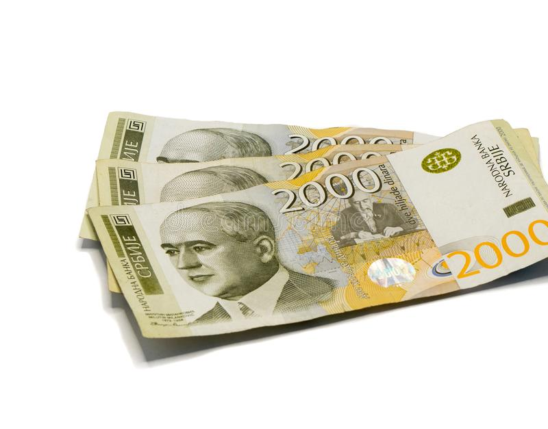 Three banknotes worth 2000 Serbian Dinars with portrait of a climate scientist Milutin Milankovic isolated on a white background. Three banknotes worth 2000 royalty free stock photos