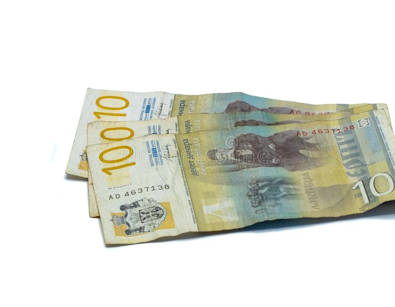 Three  banknotes worth 10 Serbian Dinars with a portrait of a Linguist Vuk Karadzic isolated on a white background. Three banknotes worth 10 Serbian Dinars with stock photography