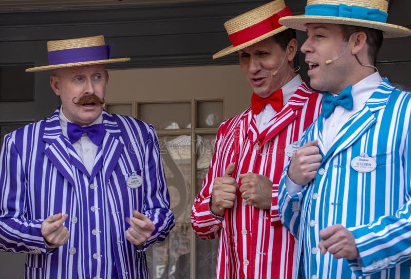 Three Barbershop Singers at Disneyland. Three of four singers entertaining guests at Disneyland, Anaheim California during the California Resident reason royalty free stock photo