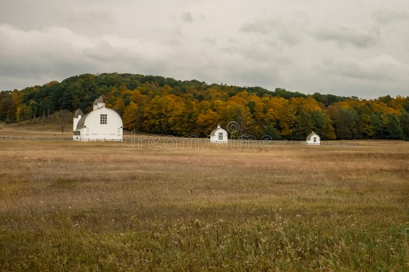 Three barns on the field in fall stock images
