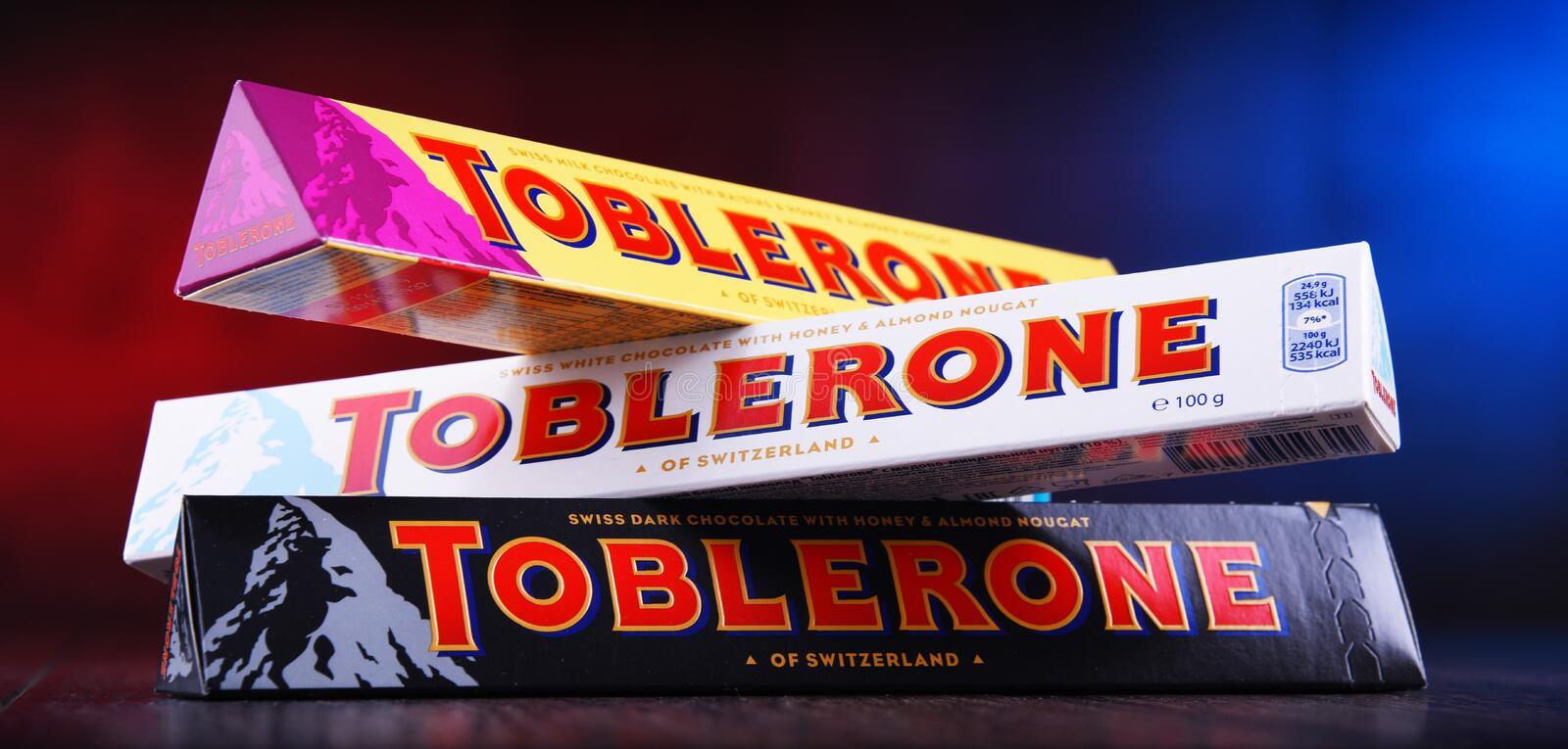 Three bars of Toblerone chocolate. POZNAN, POL - MAR 22, 2019: Three bars of Toblerone, a Swiss chocolate brand owned by US confectionery company Mondelez stock photography