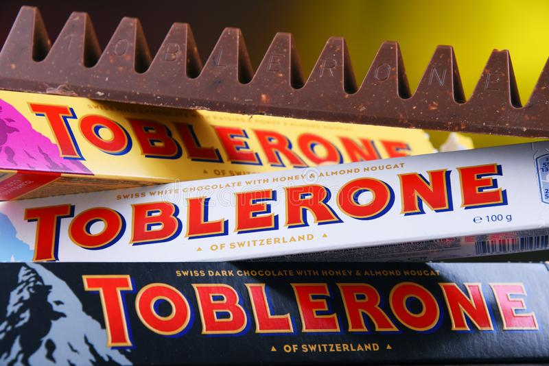 Three bars of Toblerone chocolate. POZNAN, POL - MAR 22, 2019: Three bars of Toblerone, a Swiss chocolate brand owned by US confectionery company Mondelez stock image