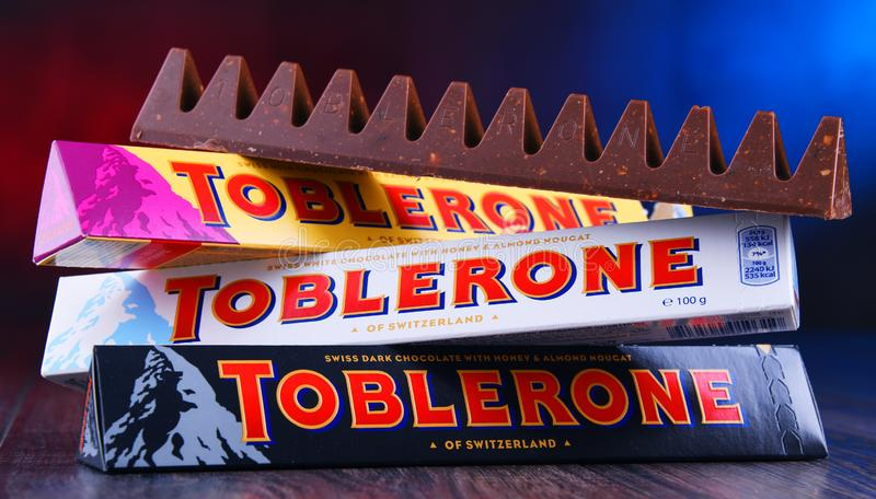 Three bars of Toblerone chocolate. POZNAN, POL - MAR 22, 2019: Three bars of Toblerone, a Swiss chocolate brand owned by US confectionery company Mondelez royalty free stock photos