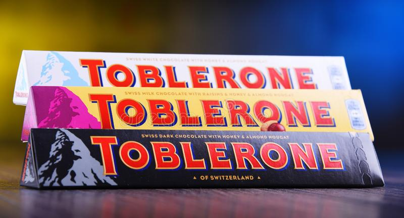 Three bars of Toblerone chocolate. POZNAN, POL - MAR 22, 2019: Three bars of Toblerone, a Swiss chocolate brand owned by US confectionery company Mondelez royalty free stock photography