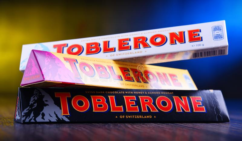 Three bars of Toblerone chocolate. POZNAN, POL - MAR 22, 2019: Three bars of Toblerone, a Swiss chocolate brand owned by US confectionery company Mondelez royalty free stock photo